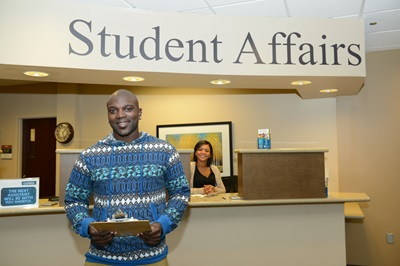 Photo of student standing in front of Student Affairs office.